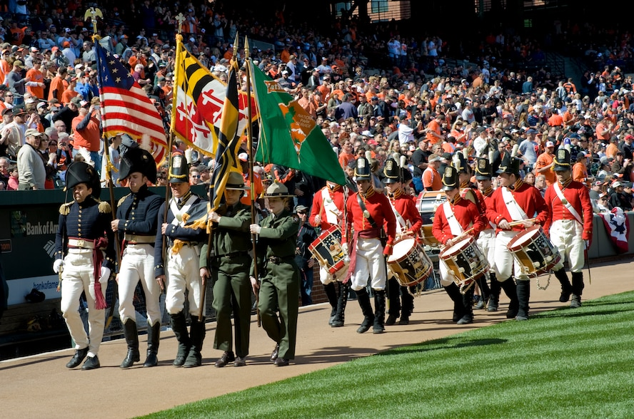 BALTIMORE, Md. -- A color guard presents the American Flag at the Baltimore Orioles' season opener April 4.  The 1st Helicopter Squadron from Joint Base Andrews, Md., contributed to the ceremonies with a flyover display during The National Anthem.    (Photo/Bobby Jones)