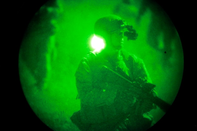 A Marine with the Assault Element of India Company, Battalion Landing Team 3/5, 15th Marine Expeditionary Unit, prepares to close with and destroy an objective during a helo raid conducted at night as a part of MEU Exercise, here, April 9. Marine Expeditionary Unit Exercise is designed to train the unit as a Marine Air Ground Task Force in preparation for their upcoming deployment. It is the first exercise that integrates all elements of the MAGTF. For many of the BLT Marines, this was their first opportunity to work with the other elements.