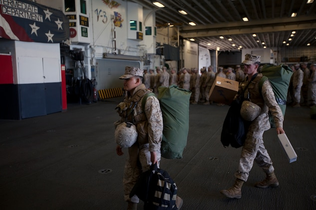 Marines of the 26th Marine Expeditionary Unit on load their gear as they board the USS Wasp at Norfolk Naval Station, Va., April 9, 2012. The 26th Marine Expeditionary Unit is currently providing support to the Commemoration of the Battle of New Orleans. Starting this April and continuing through 2015, the U.S. Navy, U.S. Marine Corps and U.S. Coast Guard will commemorate the Bicentennial of the War of 1812 and the Star Spangled Banner.  The War of 1812 celebration will commemorate the rich Naval history and showcase the capabilities of today's Navy-Marine Corps team.