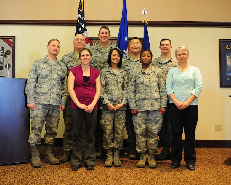The Beale Air Force Base chapel staff poses for a group photo Feb. 16 after the National Prayer luncheon at the Recce Point Club. Beale was named the 2011 Air Force Medium Chapel of the year after winning the award at the Air Combat Command level. (U.S. Air Force photo by Senior Airman Shawn Nickel)