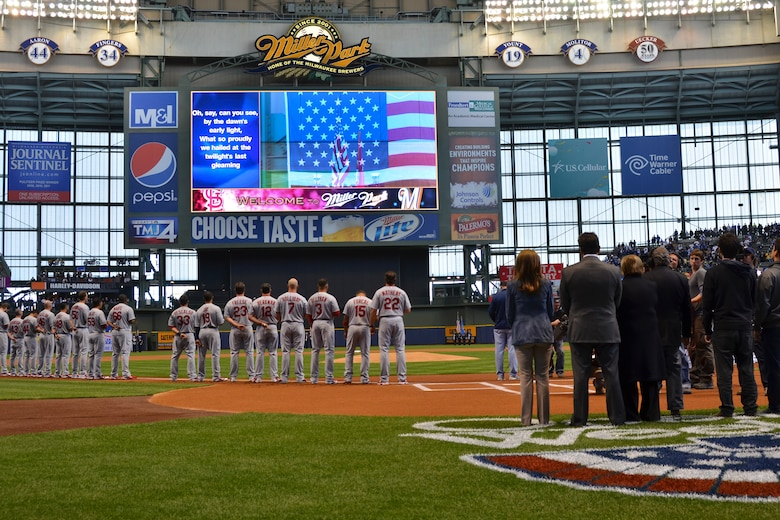 The 128th Air Refueling Wing's Honor Guard present the colors during the National Anthem for the Milwaukee Brewers' Opening Day game vs. the World Series Champion St. Louis Cardinals at Miller Park in Milwaukee Friday, April 6, 2012. The 128th's Honor Guard is a regular participant in many community events in the Milwaukee area.(U.S. Air Force Photo by: Senior Master Sgt. Jeffrey A. Rohloff) (Released)