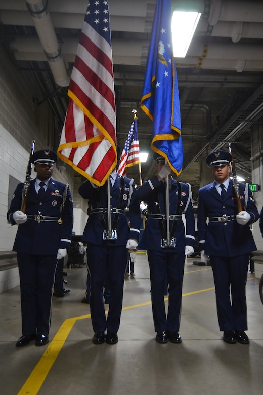 Members of the 128th Air Refueling Wing's Honor Guard, Airman First Class Petty (left), Staff Sgt. Velazquez, Master Sgt. Coker, and Airman First Class Hildebrand (right) stand ready to present the colors  just before the Milwaukee Brewers' Opening Day game vs. the World Series Champion St. Louis Cardinals at Miller Park in Milwaukee Friday, April 6, 2012. The 128th's Honor Guard is a regular participant in many community events in the Milwaukee area. (U.S. Air Force Photo by: Senior Master Sgt. Jeffrey A. Rohloff) (Released)