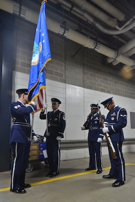 Members of the 128th Air Refueling Wing's Honor Guard, Staff Sgt. Velazquez (left) Master Sgt. Coker, Airman First Class Petty and Airman First Class Hildebrand (right) prepare the colors for presentation just before the Milwaukee Brewers' Opening Day game vs. the World Series Champion St. Louis Cardinals at Miller Park in Milwaukee Friday, April 6, 2012. The 128th's Honor Guard is a regular participant in many community events in the Milwaukee area. (U.S. Air Force Photo by: Senior Master Sgt. Jeffrey A. Rohloff) (Released)