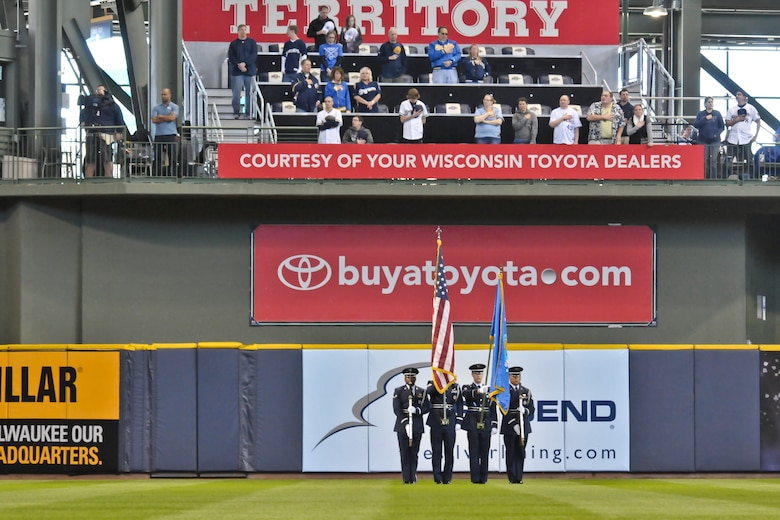 Members of the 128th Air Refueling Wing's Honor Guard present the colors during the National Anthem during pre-game festivities just before the Milwaukee Brewers' Opening Day game vs. the World Series Champion St. Louis Cardinals at Miller Park in Milwaukee Friday, April 6, 2012.  (U.S. Air Force Photo by: 2nd Lt. Nathan T. Wallin) (Released)