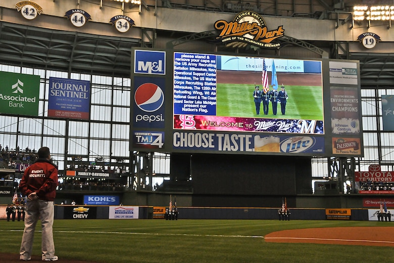 Members of the 128th Air Refueling Wing's Honor Guard appear on the big screen during the National Anthem prior to the Milwaukee Brewers' Opening Day game vs. the World Series Champion St. Louis Cardinals at Miller Park in Milwaukee Friday, April 6, 2012.  The 128th's Honor Guard is a regular participant in many community events in the Milwaukee area.    (U.S. Air Force Photo by: 2nd Lt. Nathan T. Wallin) (Released)