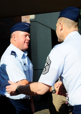 Col. Erik Hansen greets Chief Master Sergeant of the Air Force James Roy upon his arrival at Joint Base Charleston - Air Base April 9. Hansen is the 437th Airlift Wing commander. (U.S. Air Force photo/Staff Sgt. Katie Gieratz)