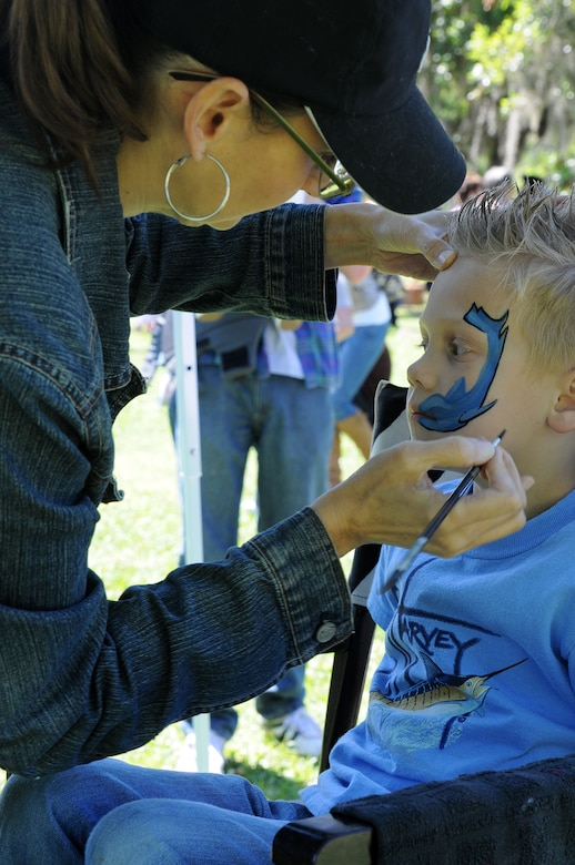 CHARLESTON, S.C. (April 7, 2012) - Shannon Boyd paints a shark on six-year old Logan Floding's face during the Easter Egg Hunt and Month of the Military Child Festival at Marrington Plantation at Joint Base Charleston – Weapons Station, April 7. Hundreds of Air Force and Navy service members and their families, along with Department of Defense employees, retirees and Reserve members joined in the festivities which featured food to choose from, games, a bouncy castle, face painting and raffle prizes. Logan is the son of Petty Officer 1st Class Zach Floding assigned to the Navy Nuclear Power Unit at JB Charleston – Weapons Station. (U.S. Navy photo/Petty Officer 1st Class Jennifer Hudson)