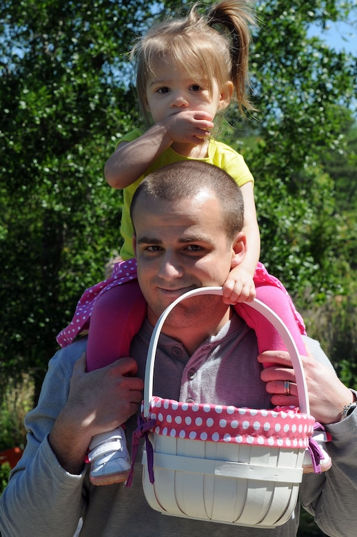 CHARLESTON, S.C. (April 7, 2012) Ensign Philip Nadenbousch gives his two-year-old daughter, Evelyn, a ride on his shoulders during the Easter Egg Hunt and Month of the Military Child Festival at Marrington Plantation at Joint Base Charleston – Weapons Station April 7. Hundreds of Air Force and Navy service members and their families, along with Department of Defense employees, retirees and Reserve members joined in the festivities which featured food to choose from, games, a bouncy castle, face painting and raffle prizes. Ens. Nadenbousch is assigned to the Naval Nuclear Power Training Command at JB Charleston – Weapons Station. (U.S. Navy photo/Petty Officer 1st Class Jennifer Hudson)