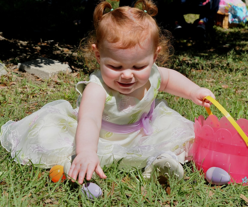 120407-N-IW469-018 CHARLESTON, S.C. (April 7, 2012) Staff Sgt. Bryan Weaber's 18-month old daughter Rachael, plays with a plastic egg at the Easter Egg Hunt and Month of the Military Child Festival at Marrington Plantation at Joint Base Charleston – Weapons Station April 7. Hundreds of Air Force and Navy service members and their families, along with Department of Defense employees, retirees and Reserve members joined in the festivities which featured food to choose from, games, a bouncy castle, face painting and raffle prizes. Weaber is assigned to the 628th Communication Squadron at JB Charleston – Air Base.  (U.S. Navy photo/Petty Officer 1st Class Jennifer Hudson)