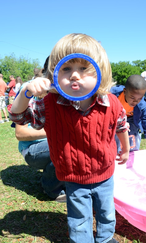 CHARLESTON, S.C. (April 7, 2012) - Two-year-old Eli Brading attempts to blow a bubble as big as his head while playing at the bubble pool during the Easter Egg Hunt and Month of the Military Child Festival held at Marrington Plantation at Joint Base Charleston-Weapons Station April 7. The event was open to service members, Department of Defense personnel and their families and provided games, food and fun for the whole family. Eli is the son of Airman 1st Class Tom Brading, 628th Air Base Wing Public Affairs Specialist. (U.S. Air Force Photo / Airman 1st Class Tom Brading)