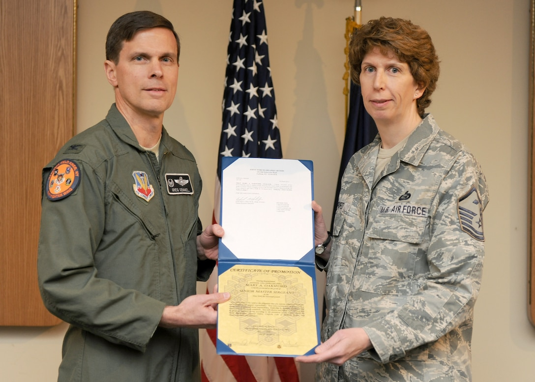 New York Air National Guard Master Sgt. Mary Oaksford, 174th Fighter Wing First Sergeant, was promoted to Senior Master Sergeant by Col. Greg Semmel, 174th Fighter Wing Commander, during a ceremony held at Hancock Field Air National Guard Base in Syracuse, NY on 1 April 2012. (Photo by Tech Sgt. Ricky Best/RELEASED)