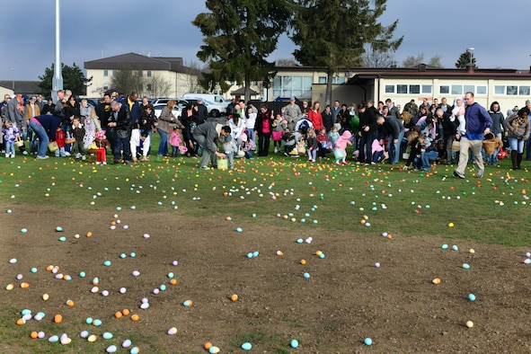 SPANGDAHLEM AIR BASE, Germany – Families gather eggs during an annual Easter egg hunt in the field behind Bldg. 149 here April 7. More than 250 children and their parents participated in the event. The event was sponsored by the local Masonic community and 52nd Force Support Squadron to support Airmen and their families. (U.S. Air Force photo by Airman 1st Class Dillon Davis/Released)