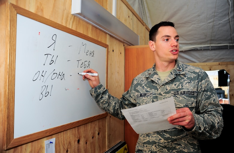 "Second Lt. Justin Miller teaches ""possessives"" of the Russian language April 5, 2012, at the Transit Center at Manas, Kyrgyzstan. Miller teaches a basic Russian language class twice a week at the Theater Security Cooperation division to enable service members to engage in basic Russian conversations. Miller is the 376th Air Expeditionary Wing TSC host nation liaison branch chief and is deployed here from Beale Air Force Base, Calif. (U.S. Air Force photo/Staff Sgt. Angela Ruiz)"