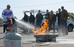 FOLSOM, Calif. -- Fred Strickland, an engineer with the U.S. Army Corps of Engineers Sacramento District, douses a ring of propane fire during a training exercise here, April 7, 2012. Strickland and nearly 20 Corps employees participated in yearly fire extinguisher safety training, mandated by Occupational Safety and Health Administration, and conducted by the district's safety office. The training included a video presentation, group discussion, followed by a timed live-fire exercise.