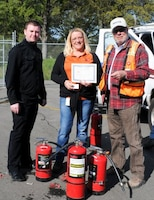FOLSOM, Calif. --(From left) Jason Walsh and Sue Fox, safety specialists; and Dan Williams, safety officer from the U.S. Army Corps of Engineers Sacramento District, prepare to award certificates of completion for the yearly fire extinguisher safety training here, April 7, 2012. The training, mandated by Occupational Safety and Health Administration and conducted by the district's safety office, included a video presentation, group discussion, followed by a timed live-fire exercise.