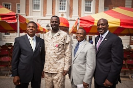 Sergeant Maj. Carl Green, outgoing sergeant major of II Marine Expeditionary Force, poses for a photo with his mentors from the drill field, retired sergeants major James E. Moore (far left) and Ron Fetherson (right) and Carlton Kent (far right), the 16th Sergeant Major of the Marine Corps, during his relief and appointment ceremony at Marine Corps Base Camp Lejeune, N.C., Mar. 30. Green recently retired after 34 years of service in the Marine Corps.