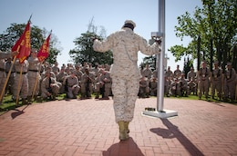 Sergeant Maj. Carl Green, outgoing sergeant major of II Marine Expeditionary Force, talks with Marines during the rehearsal of his relief and appointment ceremony at Marine Corps Base Camp Lejeune, N.C., Mar. 29. Green recently retired after 34 years of service in the Marine Corps.