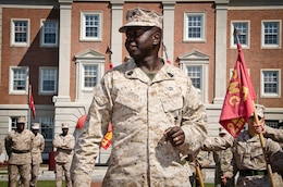 Sergeant Maj. Carl Green, outgoing sergeant major of II Marine Expeditionary Force, talks to Marines during a rehearsal for a relief and appointment ceremony aboard Marine Corps Base Camp Lejeune, N.C., Mar. 29. Green recently retired after 34 years of service in the Marine Corps.
