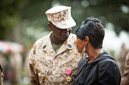 Sergeant Maj. Carl Green, outgoing sergeant major of II Marine Expeditionary Force, looks into his wife Zelda's eyes during his relief and appointment ceremony at Marine Corps Base Camp Lejeune, N.C., Mar. 30. Green recently retired after 34 years of service in the Marine Corps.