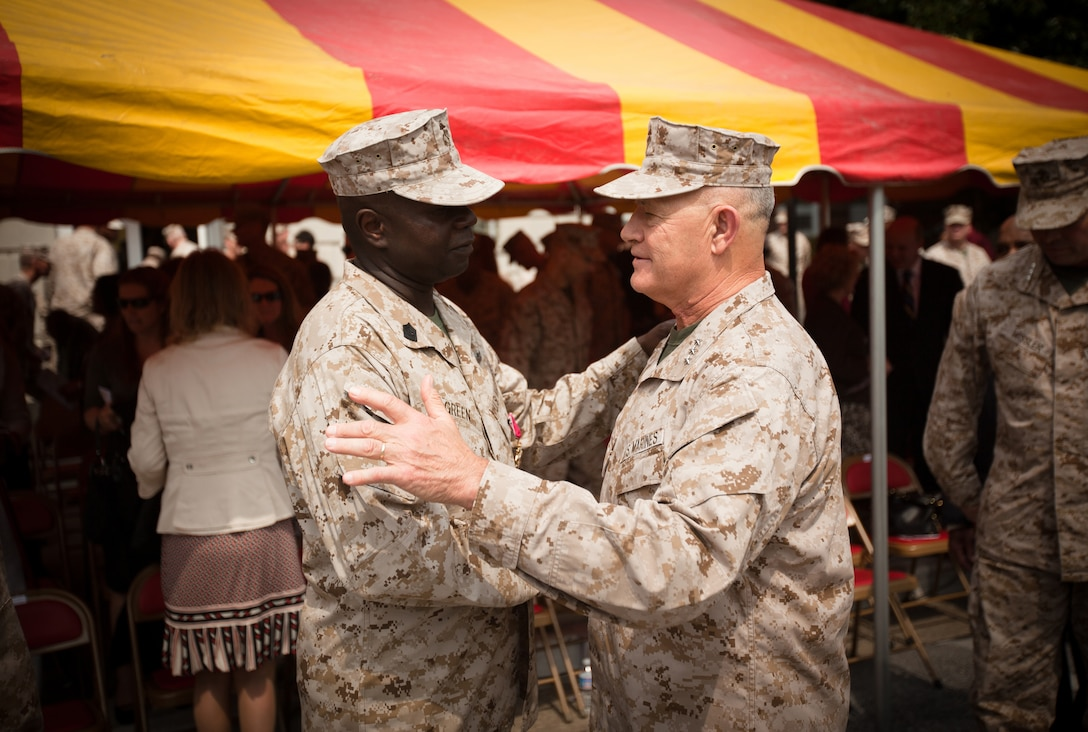 Sergeant Maj. Carl Green, outgoing sergeant major of II Marine Expeditionary Force, shares a word with Lt. Gen. Dennis J. Hejlik, the commanding general of Marine Forces Europe and United States Marine Corps Forces Command, during a relief and appointment ceremony at Marine Corps Base Camp Lejeune, N.C., Mar. 30. Green recently retired after 34 years of service in the Marine Corps.