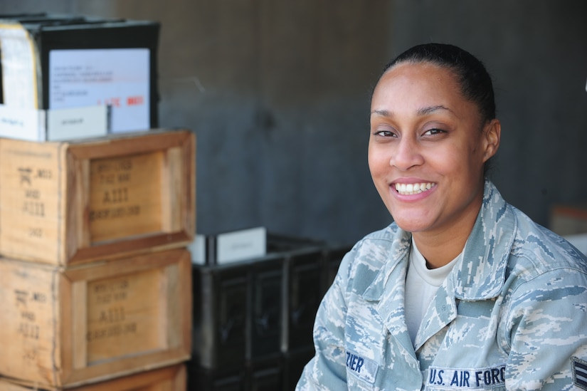 Senior Airman Caprice Frazier takes a moment for a photo after taking inventory at Joint Base Charleston - Air Base Munitions Center April 10. The 437th Maintenance Group Munitions office is responsible for more than $15 million dollars worth of munitions. Frazier is a munitions accountability technician with the 437th MXG. (U.S. Air Force photo/Staff Sgt. Katie Gieratz)