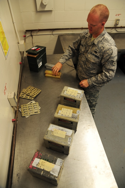 Senior Airman David Collins processes flares at the Joint Base Charleston - Air Base Munitions Center April 10. Flares are used on aircraft to deter incoming bombs. Collins is a munitions control technician with the 437th Maintenance Group Munitions office. (U.S. Air Force photo/Staff Sgt. Katie Gieratz)