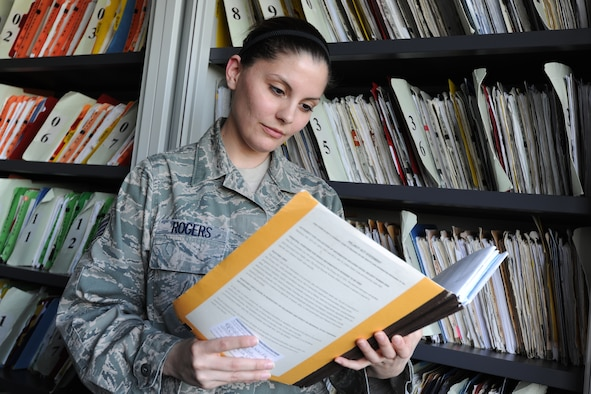 RAF CROUGHTON, United Kingdom - Staff Sgt. Nicole Rogers reviews medical records recently at the Croughton Medical Clinic. Rogers is assigned to the 422nd Air Base Group. (U.S. Air Force photo by Tech. Sgt. John Barton)
