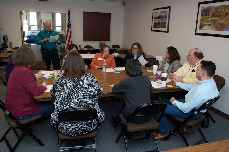 HANSCOM AIR FORCE BASE, Mass. – Participants of the family support focus group, led by facilitator Carlos Alicea (standing), discuss ideas during the Caring for People forum at the Hanscom Conference Center April 3. Throughout the day, dozens of military members, spouses and civilians employees gathered to talk about quality of life and issues that are important to them. (U.S. Air Force photo by Rick Berry)