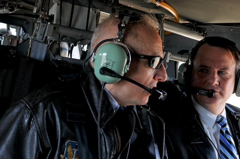 Massachusetts Lt. Gov. Timothy Murray listens to a briefing from Col. Anthony Schiavi, 102nd Intelligence Wing commander, in a U.S. Army UH-60 Blackhawk during an aerial tour of the Massachusetts Military Reservation, April 9.  Murray is currently touring military installations across Massachusetts with members of the state's Military Asset and Security Strategy Task Force in support of protecting the missions, jobs and economic investments associated with the bases. (Air National Guard photo by Tech. Sgt. Kerri Cole/Released)