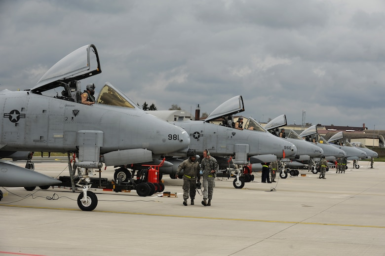 SPANGDAHLEM AIR BASE, Germany – A-10 Thunderbolt II pilots from the 81st Fighter Squadron prepare to exit their aircraft on Ramp 4 here April 10 after returning from a deployment to Bagram Airfield, Afghanistan. Friends and family waited by to greet six of the squadron's pilots who had been providing close air support during Operation Enduring Freedom. (U.S. Air Force photo by Airman 1st Class Matthew B. Fredericks/Released)