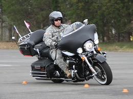 QUANTICO, Va. — Command Sgt. Maj. Michael Buxbaum, command sergeant major of the U.S. Army Corps of Engineers, maneuvers his Harley-Davidson Ultra Classic through an S-curve during the Basic Riders Course II March 16 at Marine Corps Base Quantico.