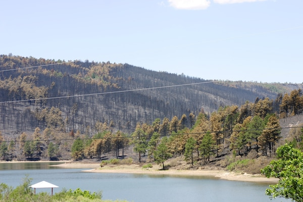RATON, N.M., -- The hills just above Raton's Lake Maloya badly burned, and officials know rain will likely bring ash, dirt and debris right into the lake. This is a problem since the majority of the town's potable water comes from the lake.