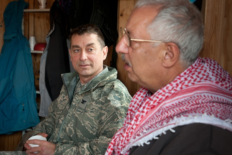Col. Warren Hurst, commander of the Kentucky Air National Guard's 123rd Contingency Response Group, meets for tea with an actor playing the role of town mayor in the fictional village of Sabor, Nessor, on March 28, 2012. Hurst was participating in Eagle Flag, an exercise designed to simulate a deployed environment at Joint Base McGuire-Dix-Lakehurst, N.J. (U.S. Air Force photo by Maj. Dale Greer)