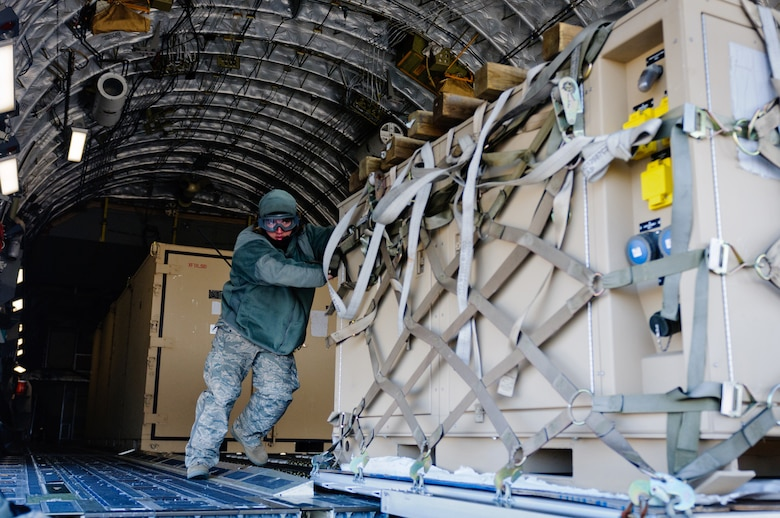 Staff Sgt. Brian Leach, aerial port ramp supervisor for the Kentucky Air National Guard's 123rd Contingency Response Group, pushes a pallet of cargo from a C-17 during Exercise Eagle Flag at Joint Base McGuire-Dix-Lakehurst, N.J., on March 28, 2012. The unit, from Louisville, Ky., joined forces with the U.S. Army's 690th Rapid Port Opening Element from Fort Eustis, Va., to establish a Joint Task Force-Port Opening through March 30. (U.S. Air Force photo by Master Sgt. Phil Speck)