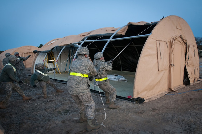 Airmen from the Kentucky Air National Guard's 123rd Contingency Response Group set up an Alaskan Shelter tent at Joint Base McGuire-Dix-Lakehurst, N.J., March 26, 2012, during Exercise Eagle Flag. More than 80 Airmen from the Kentucky Air Guard have joined forces with over 50 active-duty Army troops and Air Guardsmen from New Jersey and Mississippi to establish an aerial port at Lakehurst Naval Air Engineering Station within 24 hours of arrival. Inspectors from U.S. Transportation Command will evaluate the performance of the Kentucky unit during the exercise. (U.S. Air Force photo by Maj. Dale Greer)