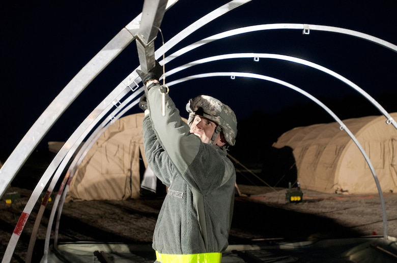 1st Lt. Kevin Eilers of the Kentucky Air National Guard's 123rd Contingency Response Group sets up an Alaskan Shelter tent at Joint Base McGuire-Dix-Lakehurst, N.J., March 26, 2012, during Exercise Eagle Flag. More than 80 Airmen from the Kentucky Air Guard have joined forces with over 50 active-duty Army troops and Air Guardsmen from New Jersey and Mississippi to establish an aerial port at Lakehurst Naval Air Engineering Station within 24 hours of arrival. Inspectors from U.S. Transportation Command will evaluate the performance of the Kentucky unit during the exercise. (U.S. Air Force photo by Master Sgt. Phil Speck)