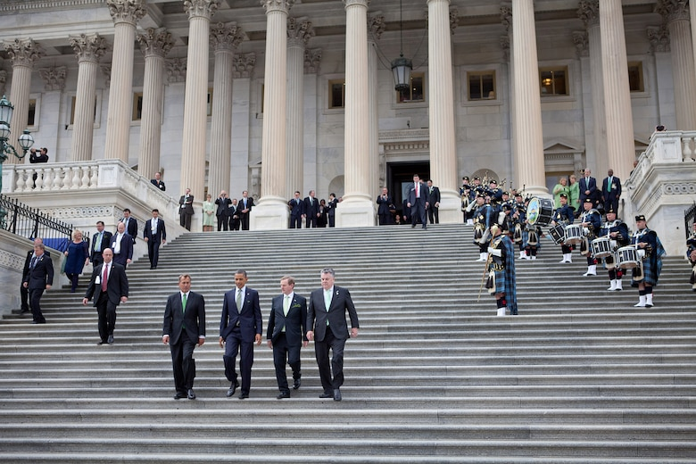 President Barack Obama walks down the steps with Prime Minister (Taoiseach) Enda Kenny of Ireland, House Speaker John Boehner and Rep. Peter King at the U.S. Capitol in Washington, D.C., March 20, 2012. The Band of the Air Force Reserve Pipe Band performed throughout the day's events, including the traditional walk down the capitol steps. (Official White House Photo by Sonya N. Hebert)