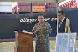 GEORGIA — Col. Jeff M. Hall, commander of the U.S. Army Corps of Engineers Savannah District, speaks at a press conference announcing the release of the Final Report for the Savannah Harbor Expansion Project, April 11, 2012. Pictured right is Curtis Foltz, executive director for the Georgia Ports Authority, who also attended and spoke at the press conference. In the background, a cargo ship sails up the Savannah River toward the Garden City Terminal. The event took place at the Corps' maintenance depot located on the Hutchinson Island side of the Savannah River.