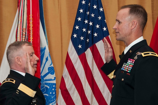"SAN FRANCISCO, Calif. - Maj. Gen. Merdith ""Bo"" Temple administers the oath to newly promoted Brig. Gen. Michael Wehr (right) March 15."