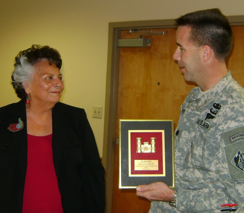 ALBUQUERQUE, N.M., -- District Commander Lt. Col. Jason Williams presents his thanks and a plaque to LaDonna Harris.