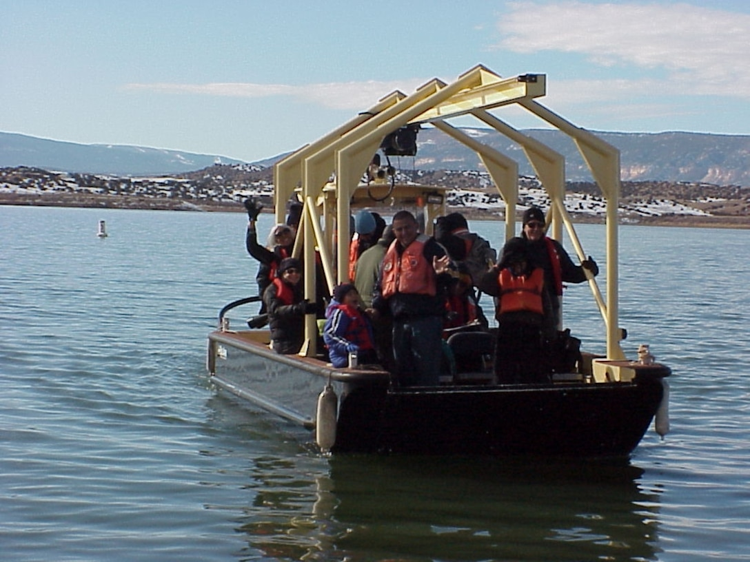 ABIQUIU, N.M., -- Volunteers at the annual Midwinter Eagle Watch look for Bald Eagles from many areas around the project including these volunteers who were on the lake. 17 eagles were spotted this year.