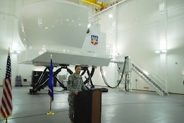 KIRTLAND AIR FORCE BASE, N.M., -- District Commander Lt. Col. Jason Williams addresses officials from Kirtland Air Force Base Jan. 19 at a ribbon-cutting ceremony to celebrate a new addition to a facility that will house HC/MC-130 aircraft simulators.