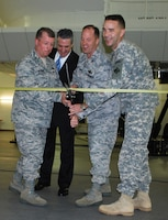 KIRTLAND AIR FORCE BASE, N.M., -- Conducting the ceremony (L to R): Col. James Cardoso, 58th Special Operations Wing Commander; Mr. Tony Frese, Lockheed Martin; Col. John Kubinec, 377 Air Base Wing Commander; Lt. Col. Jason Williams, U.S. Army Corps of Engineers.