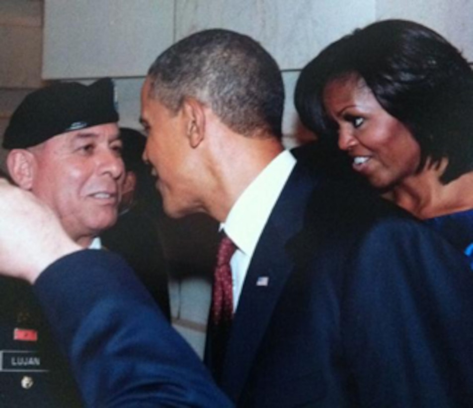 WASHINGTON D.C., -- District employee MSG Lujan gets a photo with the President and First Lady after the 2012 State of the Union Address.