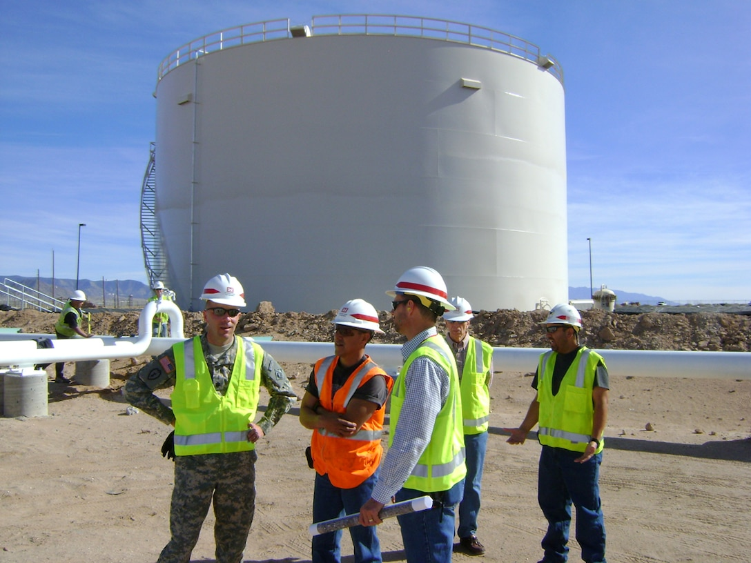 KIRTLAND AIR FORCE BASE, N.M., -- In May 2011, Environmental Project Manager Walt Migdal accompanied District Commander Lt. Col. Williams (left) on a tour of a military construction project to remove and replace an