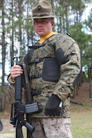 Gunnery Sgt. Joshua A. Peterson, a member of the Marine Corps Shooting Team, dropped only twelve out of 600 points in a recent competition at the Stone Bay ranges aboard Marine Corps Base Camp Lejeune. His exceptional shooting and regular work on the range are aided by specially designed shooting gear and a custom rifle.