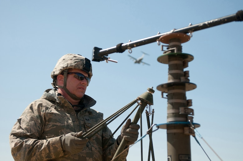 Staff Sgt. Michael Railey, a communication specialist in the Kentucky Air National Guard's123rd Contingency Response Group, assembles an antenna group at Joint Base McGuire-Dix-Lakehurst, N.J., on March 27, 2012. Railey was participating in a U.S. Transportation Command exercise designed to test the Kentucky unit's ability to establish a Joint Task Force-Port Opening within 24 hours of arrival. (U.S. Air Force photo by Master Sgt. Phil Speck)
