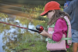 CALHOUN FALLS, S.C. — A child casts her rod in hopes to land a catfish at the 2011 Kid's Fishing Derby hosted by the Army Corps of Engineers at Lake Richard B. Russell.