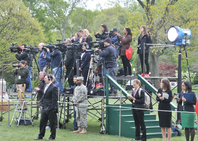 The White House Press Corps gathers on the South Lawn to witness Sidewinder's perfomance, April 11.  Sidewinder, the rock element of the 571st Air National Guard Band of the Central States, was invited by Mrs. Michelle Obama and Dr. Jill Biden to perform for the first anniversary of their Joint Forces Initiative.  Sidewinder is based at the 131st Bomb Wing – Lambert Air National Guard Base-Saint Louis. (Photo by Senior Master Sgt. Mary-Dale Amison)