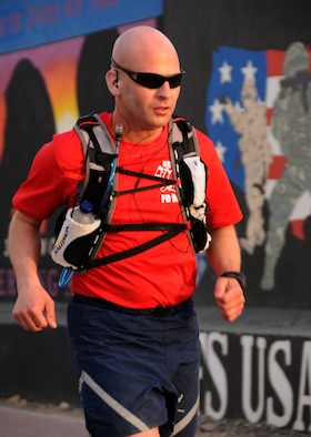 U.S. Air Force Tech. Sgt. Wayne Jenderny, 386th Expeditionary Civil Engineering Squadron firefighter, runs with the goal of reaching 100 miles in less than 24 hours at an undisclosed location, Southwest Asia, April 7, 2012. Jenderny, Minnesota Air National Guard member deployed from the 148th Fighter Wing and native of Eyota, Minn., ran 100 miles in less than 24 hours to raise awareness and take donations for a fellow firefighter's daughter who is suffering from a painful nerve disorder. (U.S. Air Force photo by Staff Sgt. James Lieth)